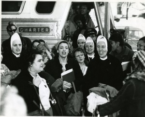 Mary Griffin (right of center) and Mundelein College students returning from the Selma March (1965)