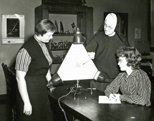 Sister Mary Therese Langerbeck teaching Physics to two Mundelein students