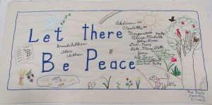 A Peace ribbon embroidered by Rose Bagley