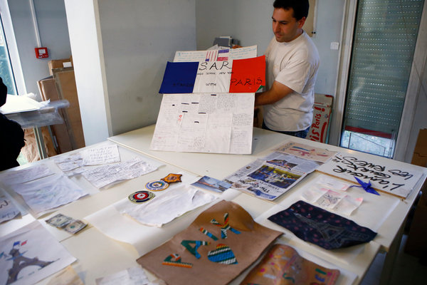 Photo by Francois Mori/Associated Press (image url: http://www.nytimes.com/2015/12/21/arts/design/in-paris-archivists-preserve-tokens-of-grief.html?_r=0)