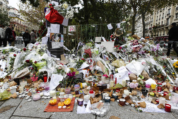 PARIS, FRANCE - NOVEMBER 17: Flowers and candles are seen at the memorial for the victims of Paris terror attacks in front of Bataclan, Boulevard Voltaire in Paris, France on November 17, 2015. Photo by Geoffroy Van der Hasselt/Anadolu Agency/Getty Images (image url: http://fox61.com/2015/12/15/paris-to-save-notes-and-drawings-left-after-the-attacks/)