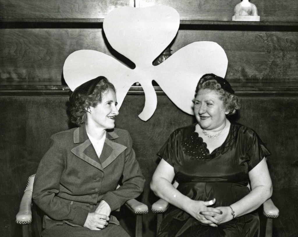 Two women enjoy the St. Patrick's Day Dinner, 1956.