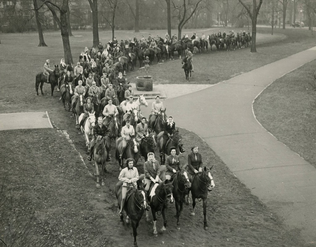 Photo of dozens of riders (some from Mundelein College Riding Club) on the Annual Breakfast Ride through Lincoln Park on November 1, 1940. Mundelein Photograph Collection.