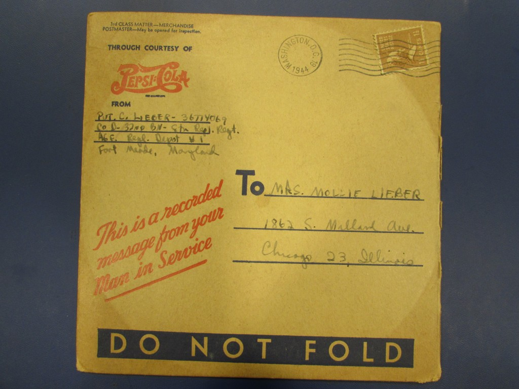 The envelope in which the vinyl record was mailed.