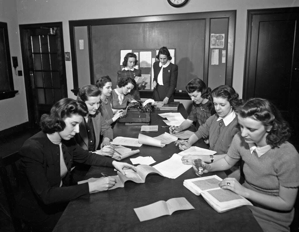 The Editorial Board of the Skyscraper hard at work getting an issue to print, 1940