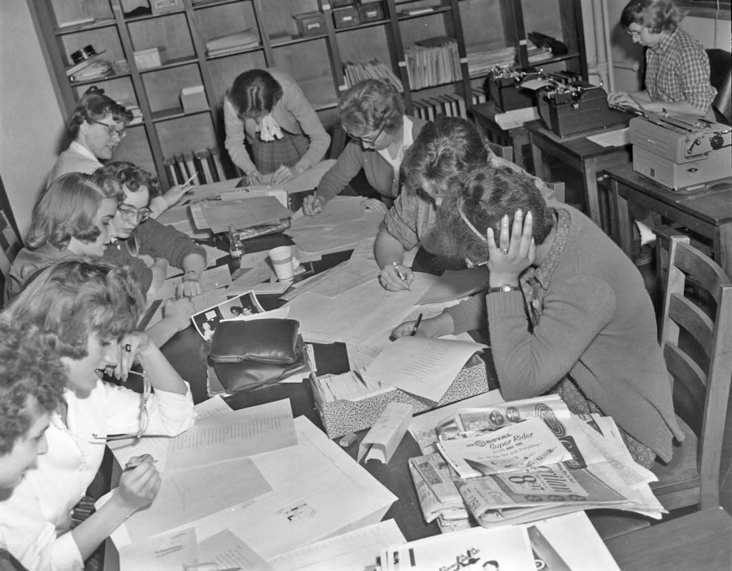 The clock is ticking! Skyscraper staff hard at work to meet their deadline, 1959