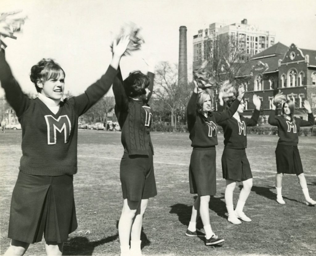 Cheerleaders spurring the 1967 team to victory
