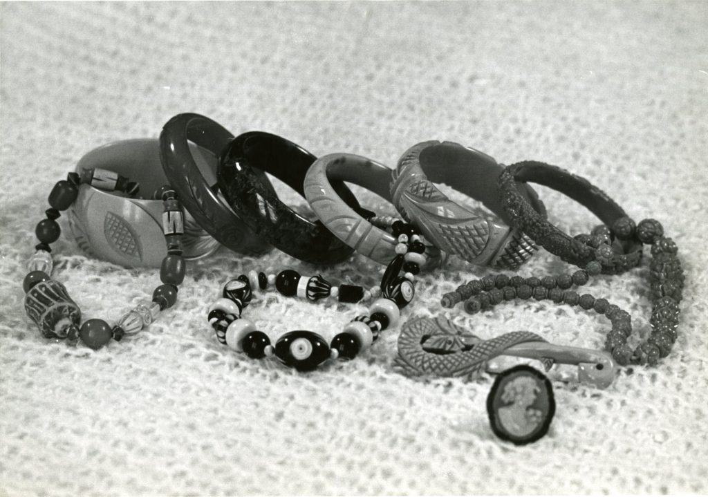 A photo of a collection of vintage and modern plastic jewelry Dr. Gordon took for use in one of her articles.